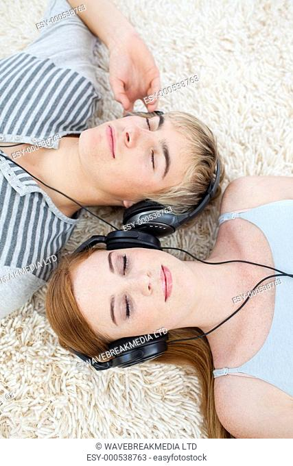Couple of young Teenagers listening to music