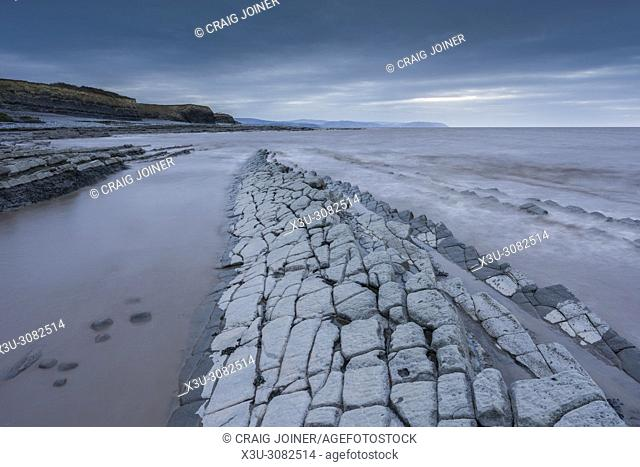Limestone rock ledges on the shore of the Bristol Channel at Kilve Beach, Somerset, England