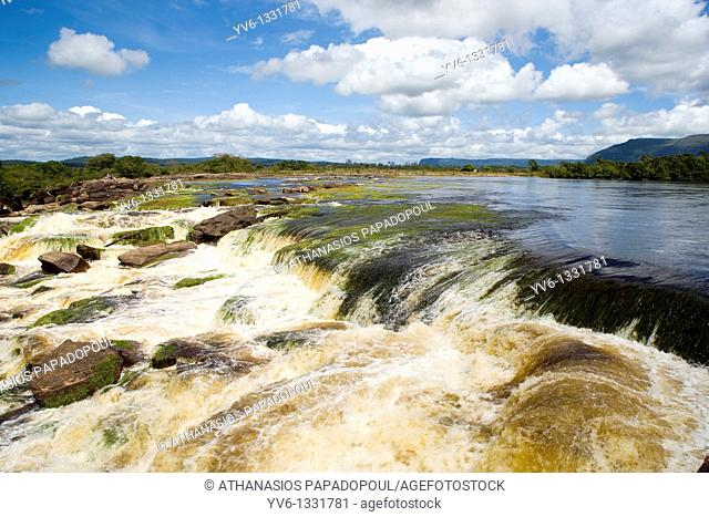 VENEZUELA GUAYANA NATIONAL PARK CANAIMA CANAIMA VILLAGE Photograph of a river just before its ending to Canaima lagoon