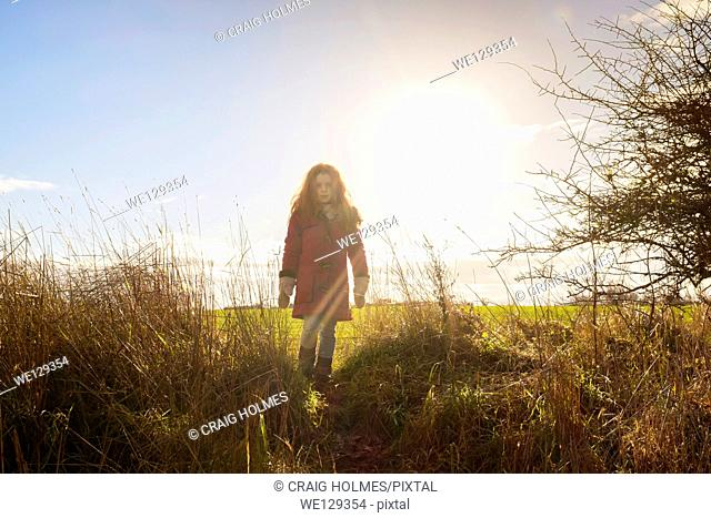 Child walking in the countryside