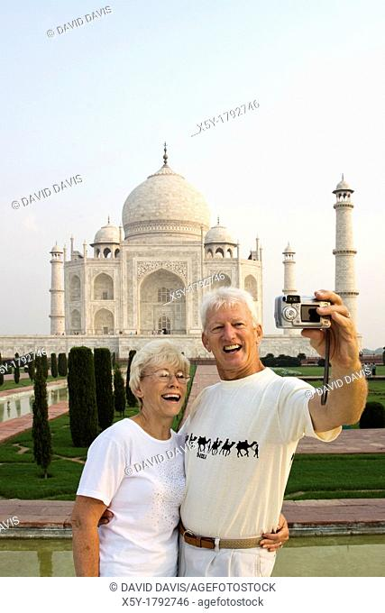 Tourist taking their picture atThe world famous Taj Mahal  The Taj Mahal is a mausoleum located in Agra, India  The Mughal Emperor Shah Jahan commissioned it as...