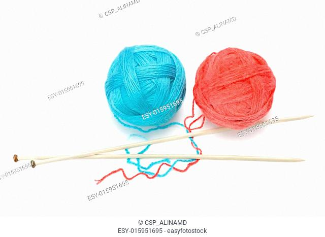 skeins of yarn and knitting needles isolated on a white backgrou