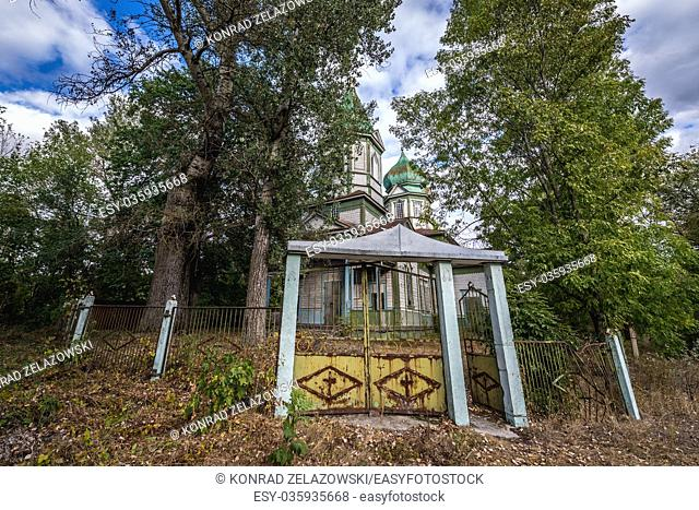 Gate of old Orthodox church of Saint Michael in Krasne, one of abandoned villages of Chernobyl Nuclear Power Plant Zone of Alienation in Ukraine