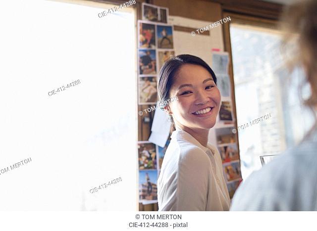 Portrait confident, smiling creative businesswoman