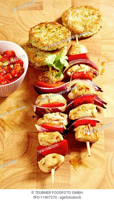 Chicken skewers with fried rice cakes