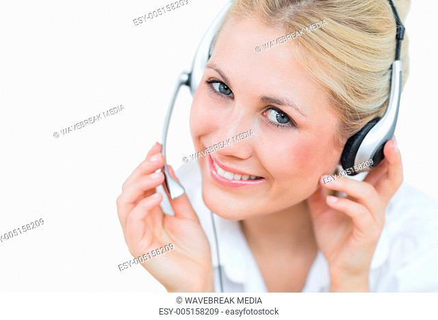 Close-up portrait of young female executive wearing headset