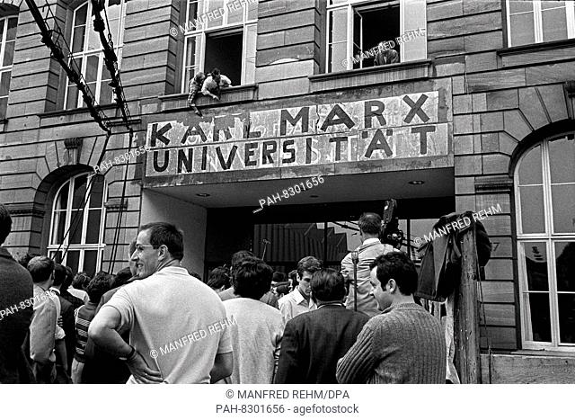 """Opponents of the renaming attempt to remove the sticker """"""""Karl Marx Universität"""""""" above the main entrance of the Johann Wolfgang Goethe University in Frankfurt..."""