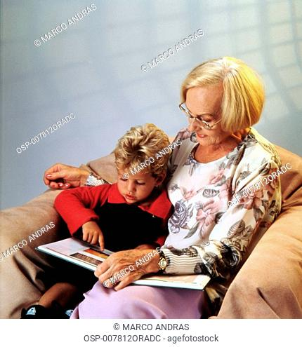 grandmother showing grandson some pictures