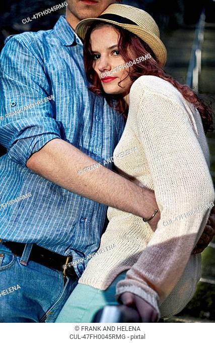 Woman hugging boyfriend outdoors