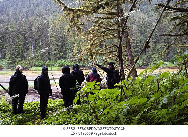 Tourists at Scenery Cove, Thomas Bay, Petersburg, Southeast Alaska. Thomas Bay is located in southeast Alaska. It lies northeast of Petersburg