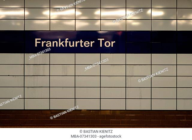 The sign of the tiled subway stop Frankfurter Tor in Berlin