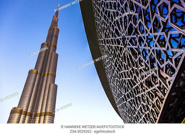 The Burj Khalifa and the Dubai Opera in Dubai, during golden hour