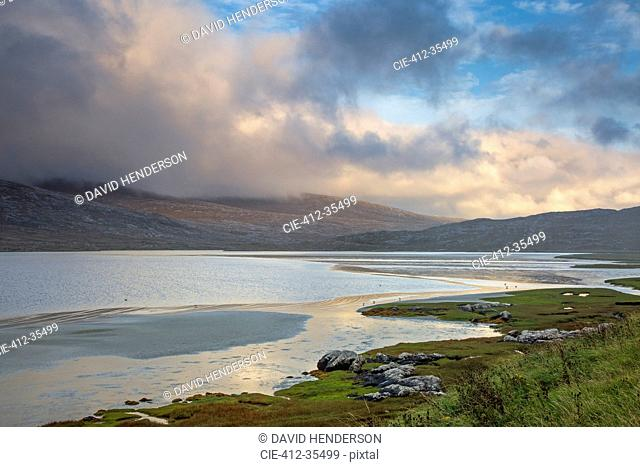 Clouds over mountains and tranquil water, Seilebost, Harris, Outer Hebrides