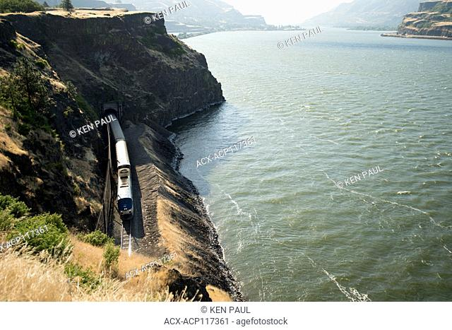Amtrak Empire Builder exits a tunnel along the Columbia River, west of Lyle, Washington, USA