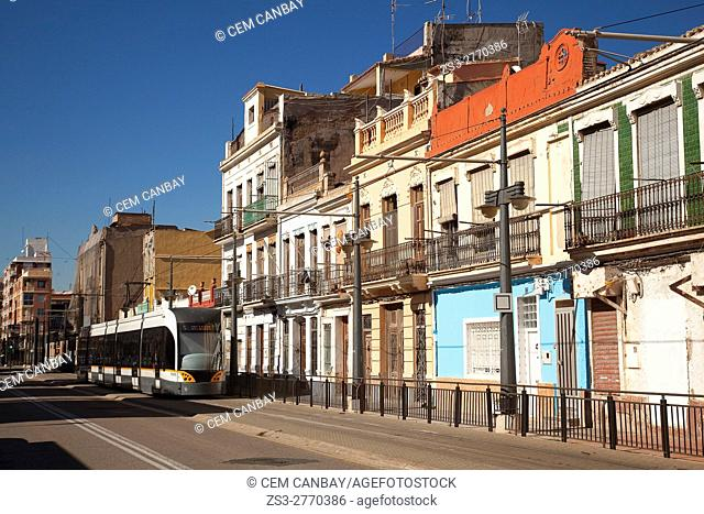 Tram in front of the buildings at the Calle del Mediterraneo street, Valencia, Spain, Europe