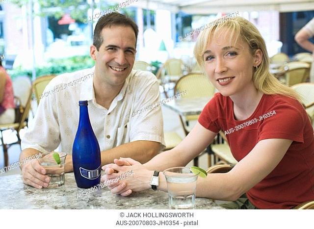 Portrait of a mid adult couple sitting in a restaurant