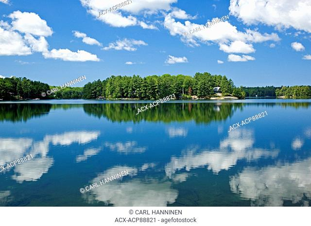 Clouds reflected in Clear Lake, near Parry Sound, Ontario, Canada