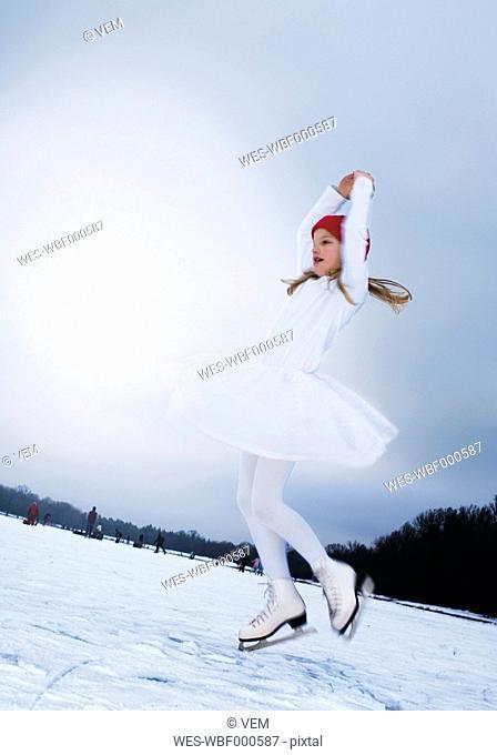 Germany, Augsburg, Girl doing ice-skating