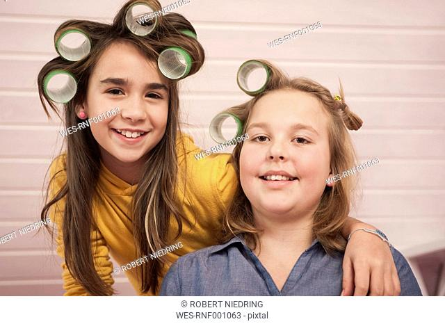 Girls with hair roller smiling, portrait, close up
