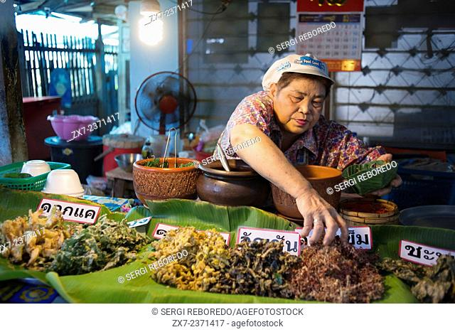 Woman seller. Food stall. Fish, vegetables, fast food. Ko Kret (also Koh Kred) is an island in the Chao Phraya River, 20 km north of Bangkok, Thailand
