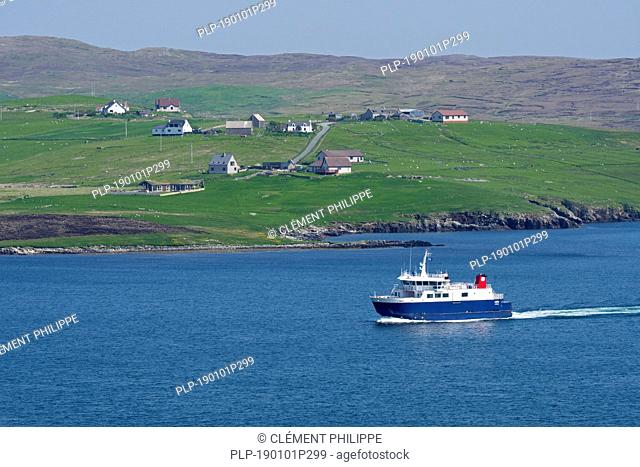 Whalsay ferry boat Linga sailing in Laxo Voe, Vidlin on the Mainland, Shetland Islands, Scotland, UK