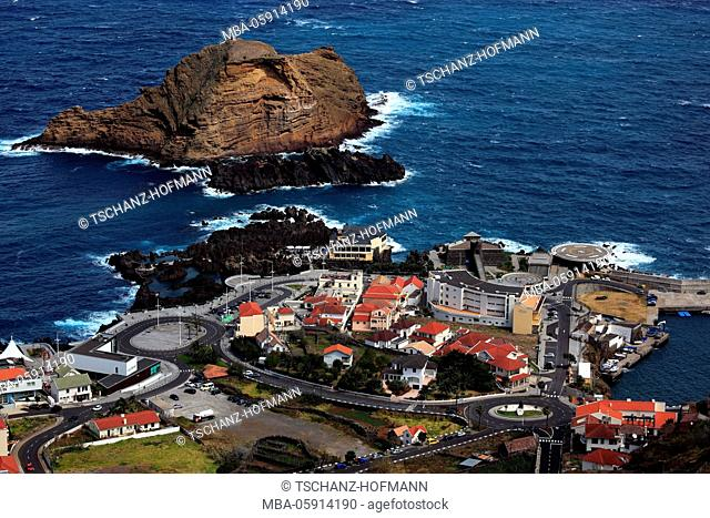 View to the village porto Moniz on the northwest coast of the island Madeira, small offshore island Ilheu mole, lava pool, outdoor swimming pool