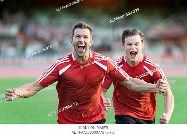 Soccer players shouting in victory