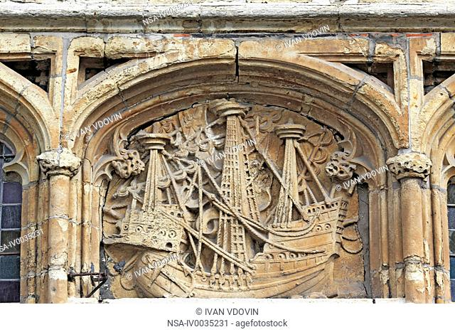 Old stone relief on facade of house with sail ship, Ghent, Belgium