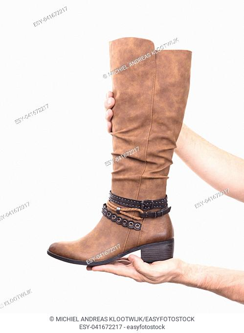 Women's high leather boot isolated on white background