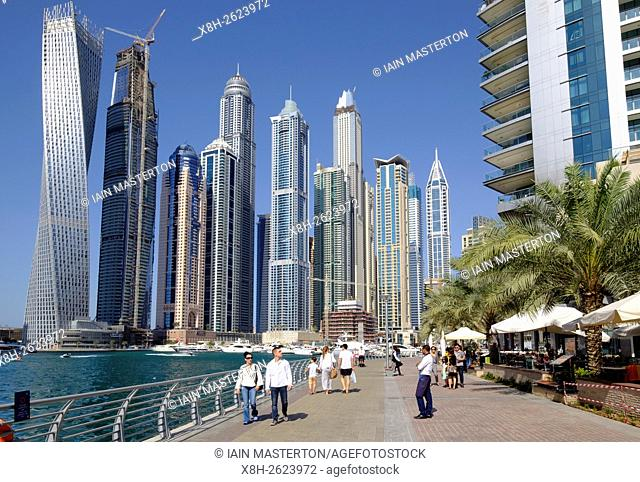 Skyline of skyscrapers and waterside promenade in Marina district of Dubai United Arab Emirates