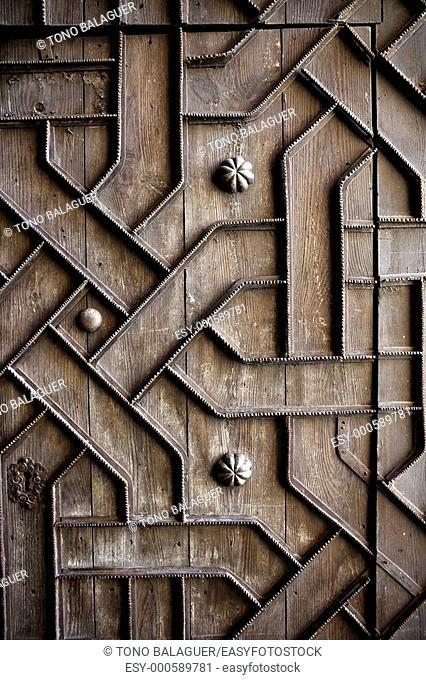 old aged wooden door with iron handcraft deco work spain church