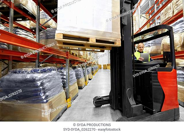 loader tablet pc and forklift at warehouse