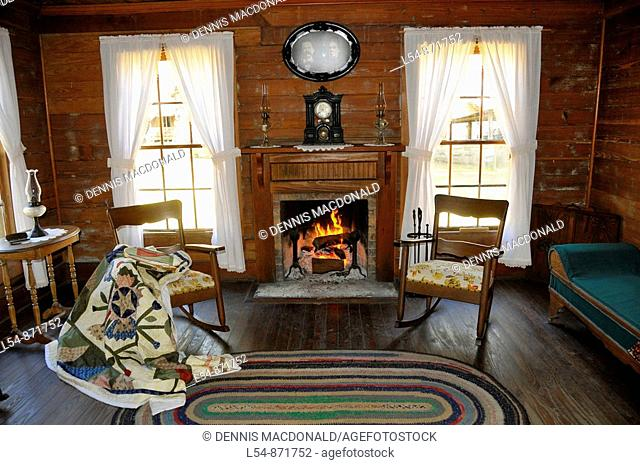 Living Room with fireplace in Carlton House Circa 1885 from Wauchula Florida at Cracker Country Florida living history museum located on the Florida State...