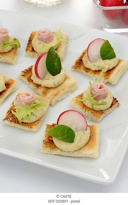 Hummus,radish and ham canapés