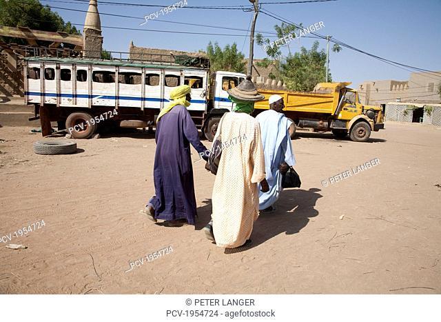 Three men at Monday Market in Djenne, Mali