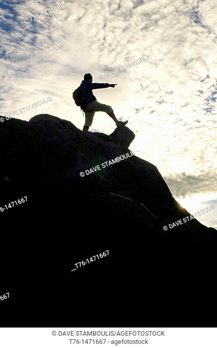 climber on the summit of Mount Kinabalu in Sabah, Borneo, Malaysia