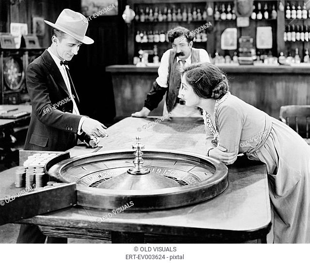 People at roulette table in bar All persons depicted are not longer living and no estate exists Supplier warranties that there will be no model release issues