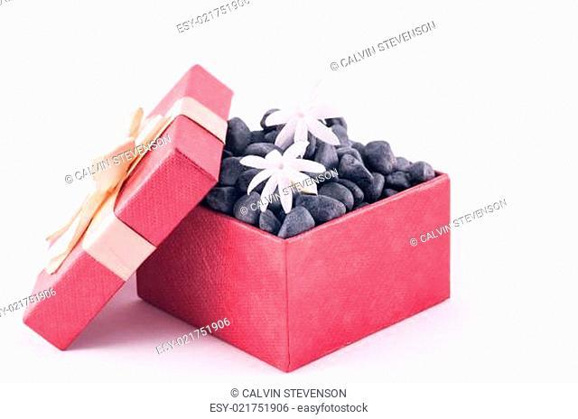 Black zen stones in a box with white Jasmine flowers