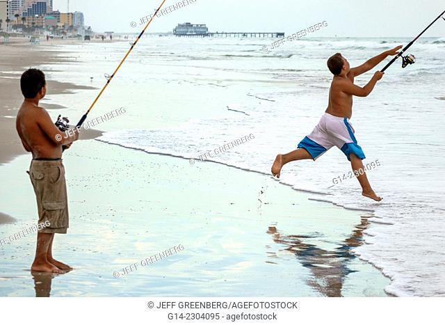Florida, Daytona Beach, Atlantic Ocean, surf, public, sand, Hispanic, boy, brothers, fishing