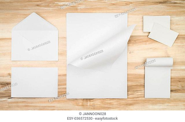 Blank envelopes ,Name card and White template paper on wooden background