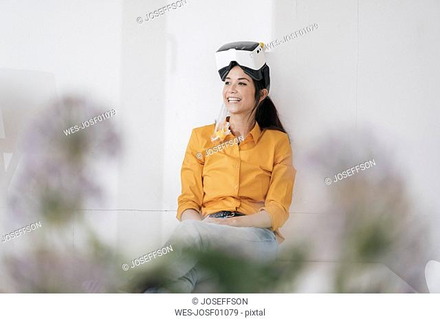 Young woman with VR glasses and snorkel planning next vacation