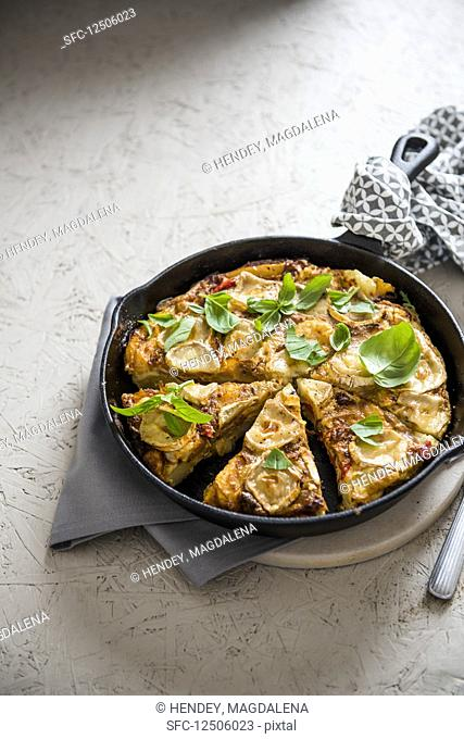 Spanish potato tortilla with red peppers and goat's cheese