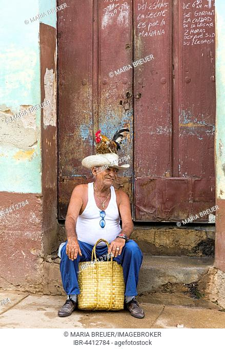 Aged Cuban man with a rooster on the head, Trinidad, Sancti Spíritus Province, Cuba