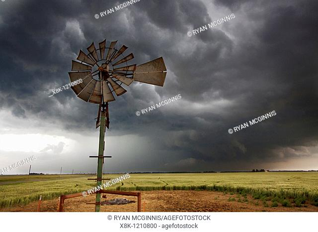 An old-fashioned windmill set against the roiling clouds of a severe thunderstorm in northern Oklahoma, May 12, 2010