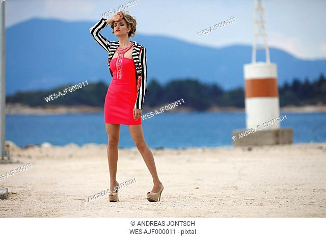 Greece, Young woman in red dress