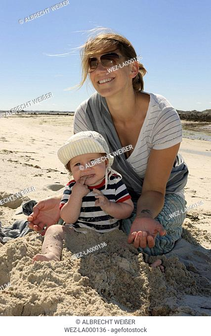 France, Bretagne, Landeda, Mother and baby boy on the beach