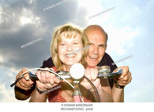 Mature couple riding bike