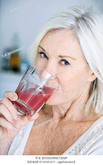 Senior woman drinking smoothie