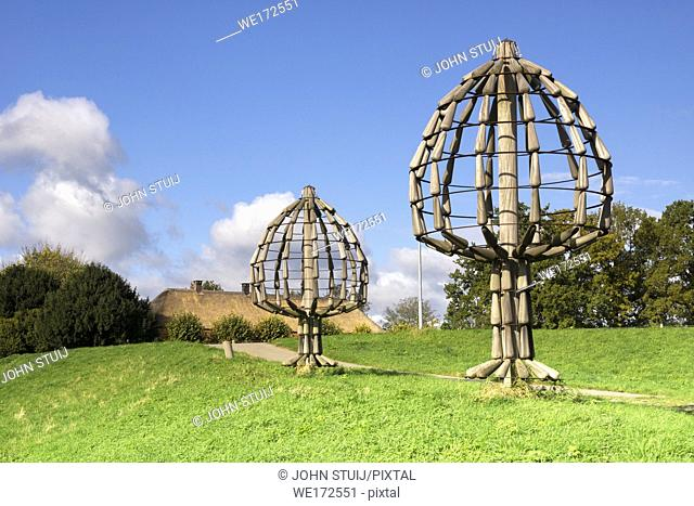 Artworks in the form of a tree along the dike of the river Maas near Batenburg in the province of Gelderland