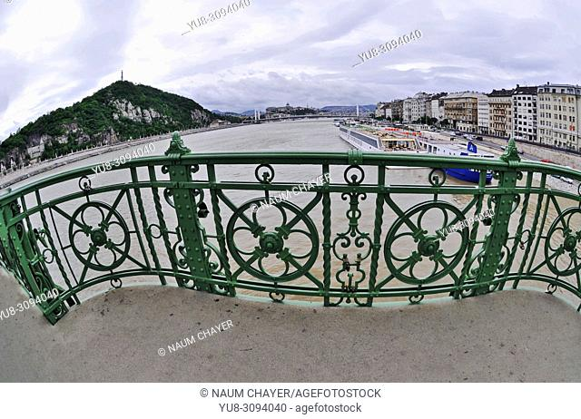 Green metal fence of Liberty Bridge and view of Danube river, Hungary, Budapest, Europe,